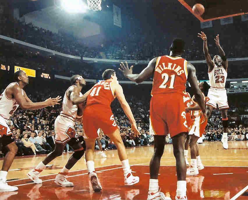 MJ doing a jump shot near the hoop