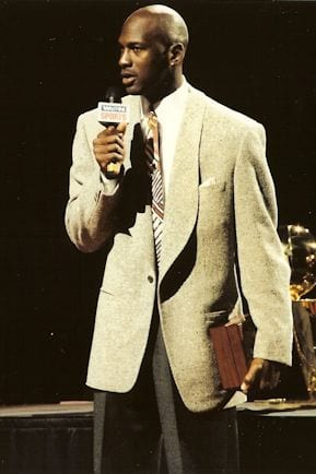 Michael Jordan holding a microphone