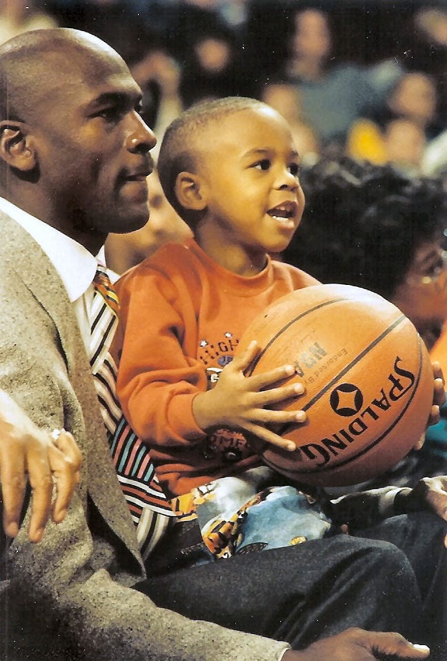 MJ's son holding a ball