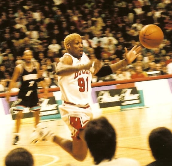 An image of Rodman chasing the ball