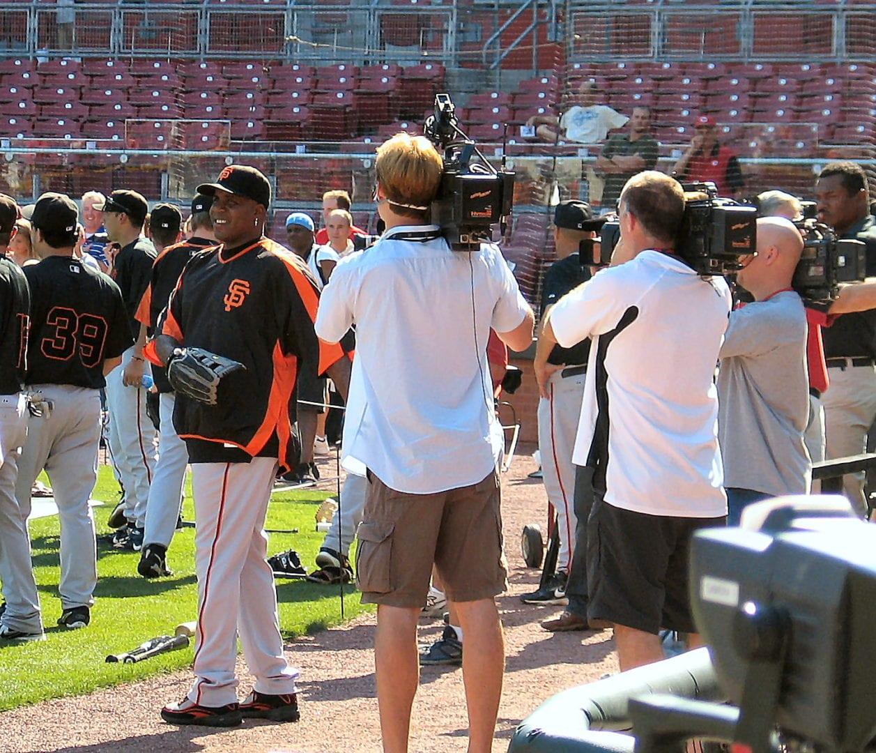 Cameramen broadcast the baseball game