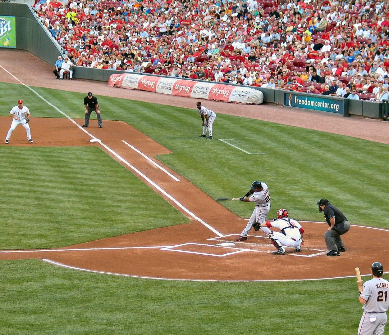 The batter doing a strike
