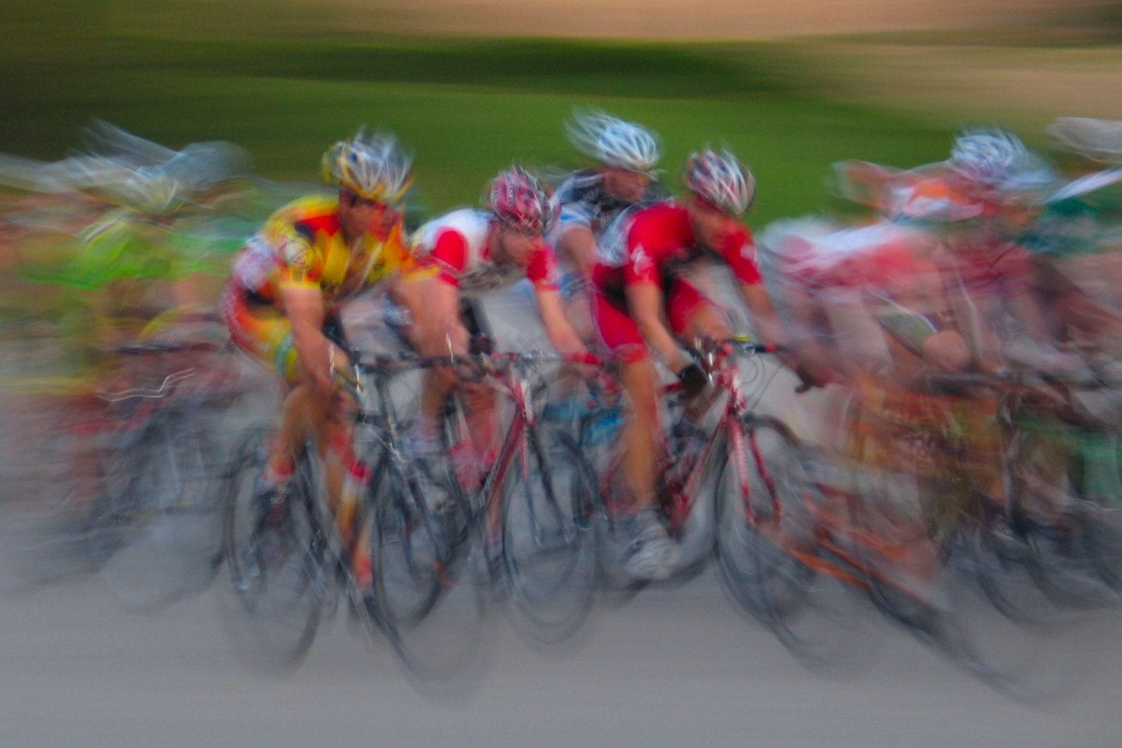 Cyclists in a blurry image