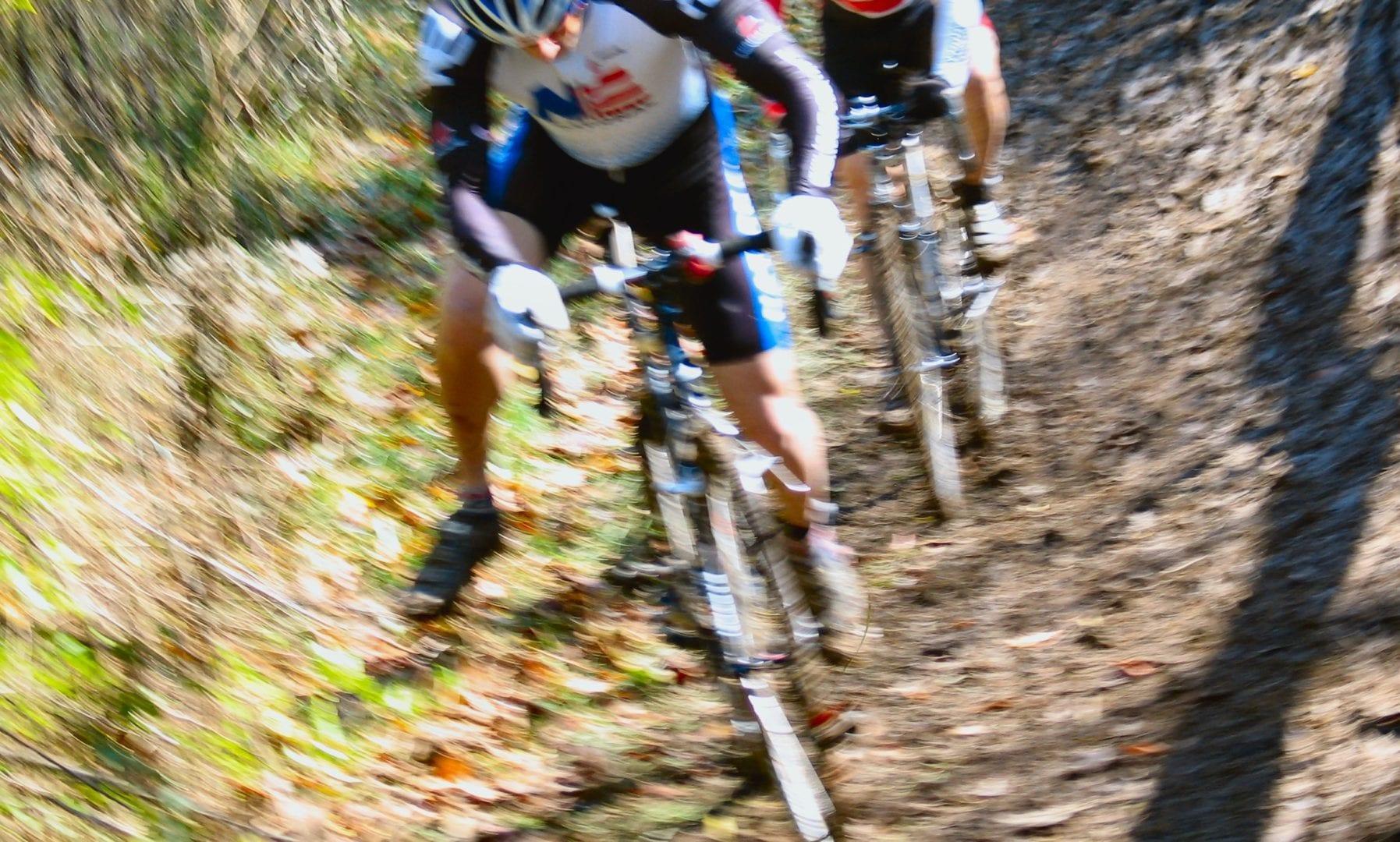 A blurry angled image of cyclists