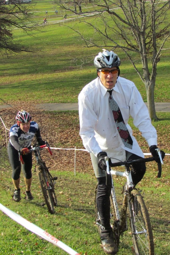 Two old cyclists moving uphill