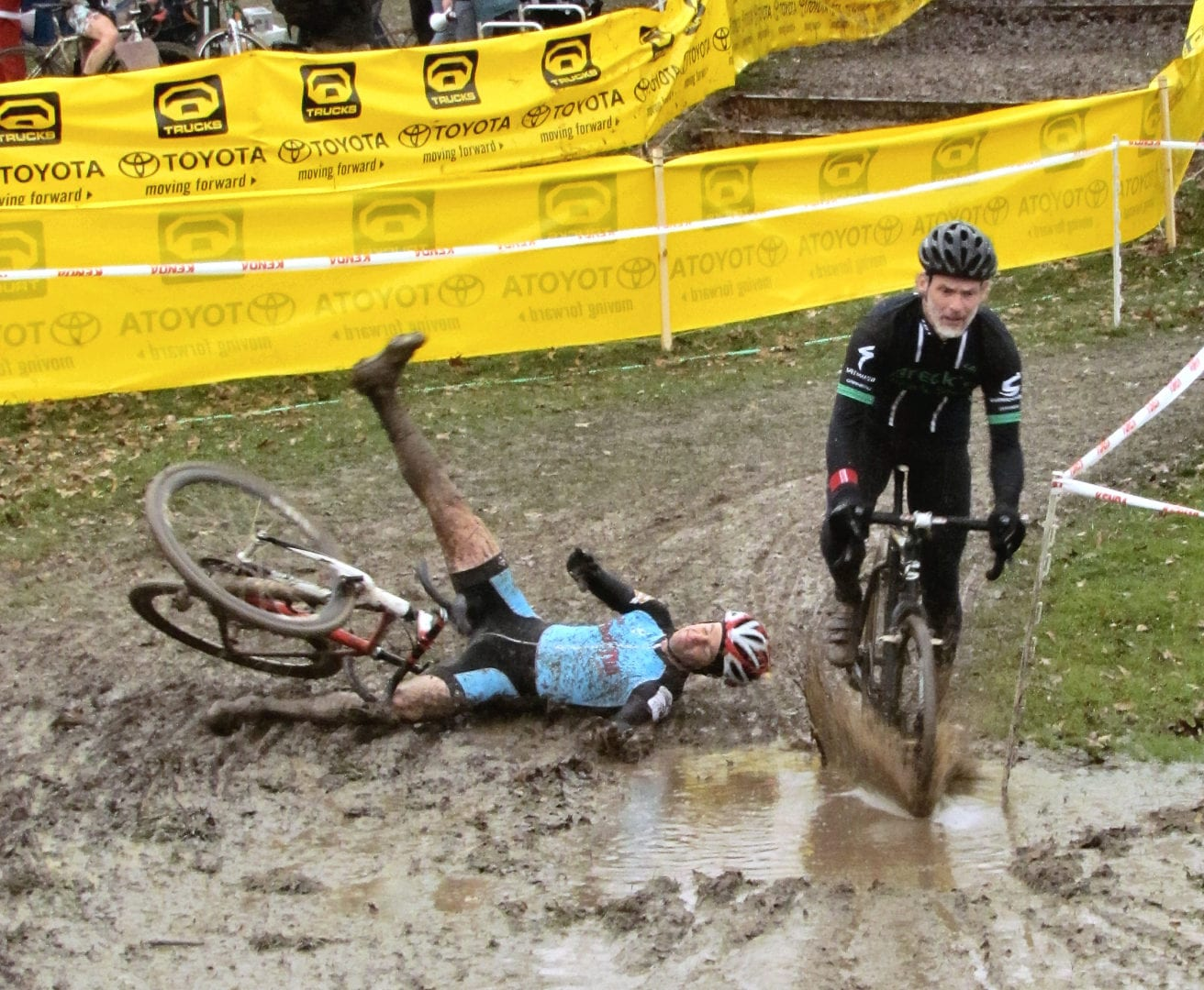 A cyclist falling on the mud
