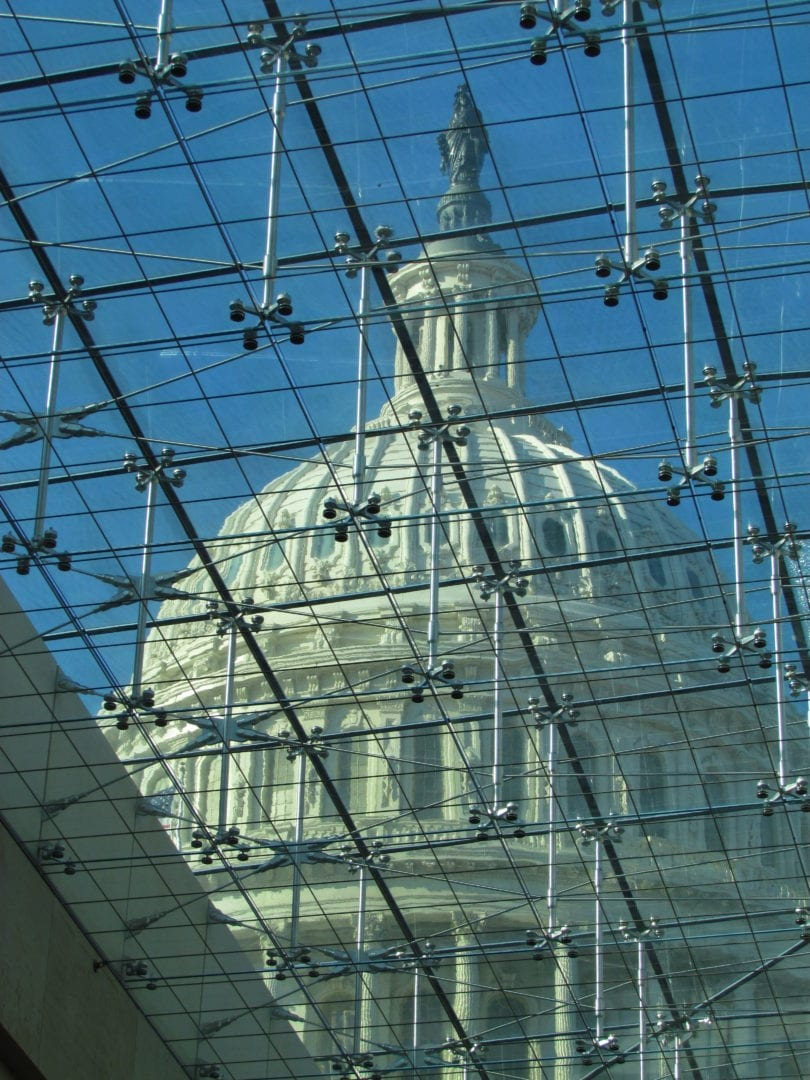 A glass roof showing a dome of a building
