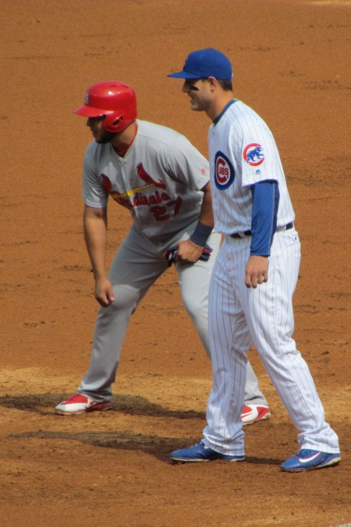 Two baseball players waiting to catch the ball