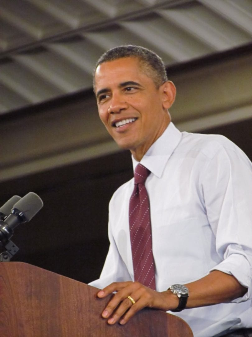 Barrack Obama smiling at the podium