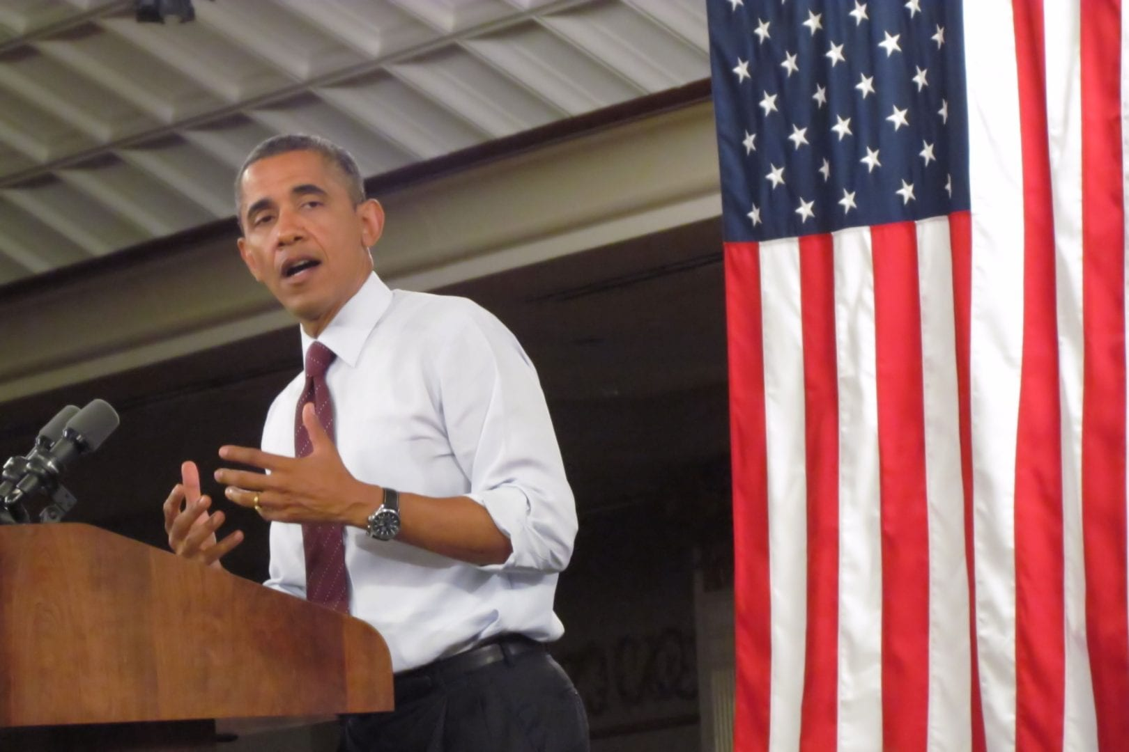 Barrack Obama giving a speech at the podium
