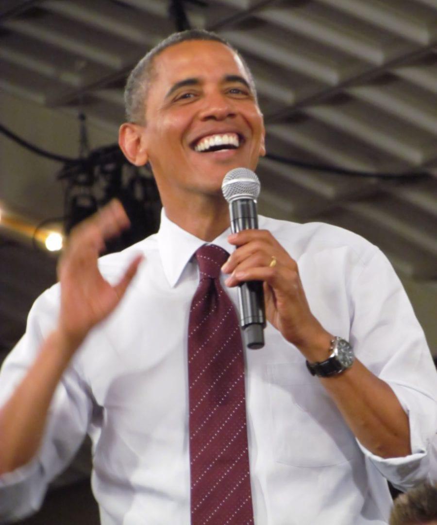 Barrack Obama smiling as he speaks