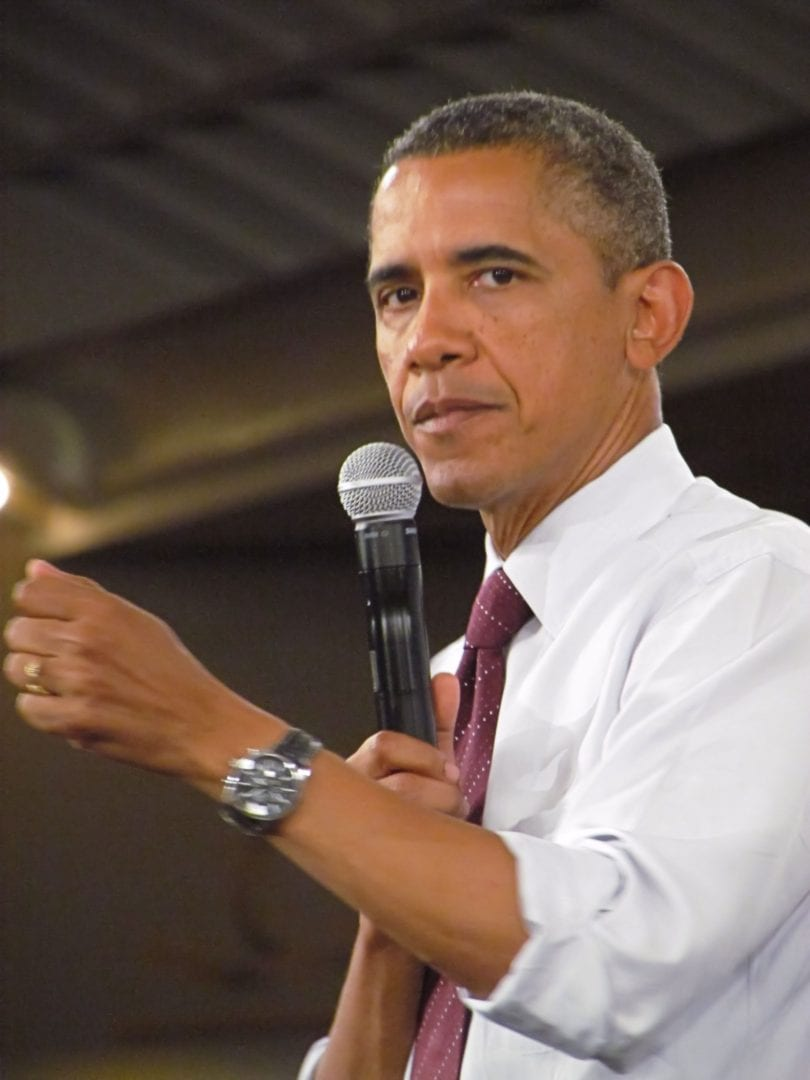 Barrack Obama moving his arm