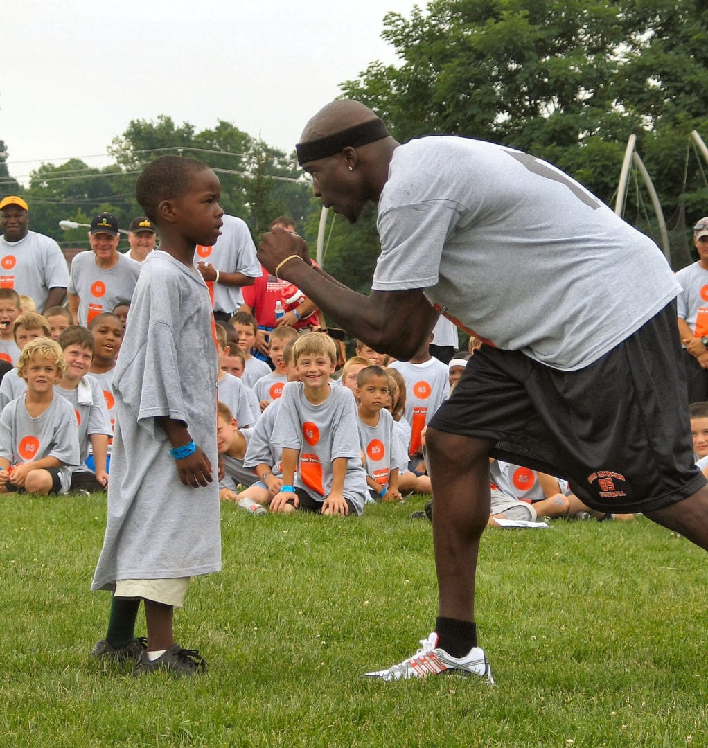 Chad Johnson with a child from youth camp