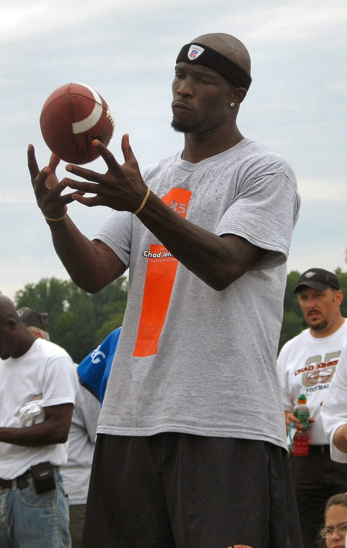 Chad Johnson tossing a football