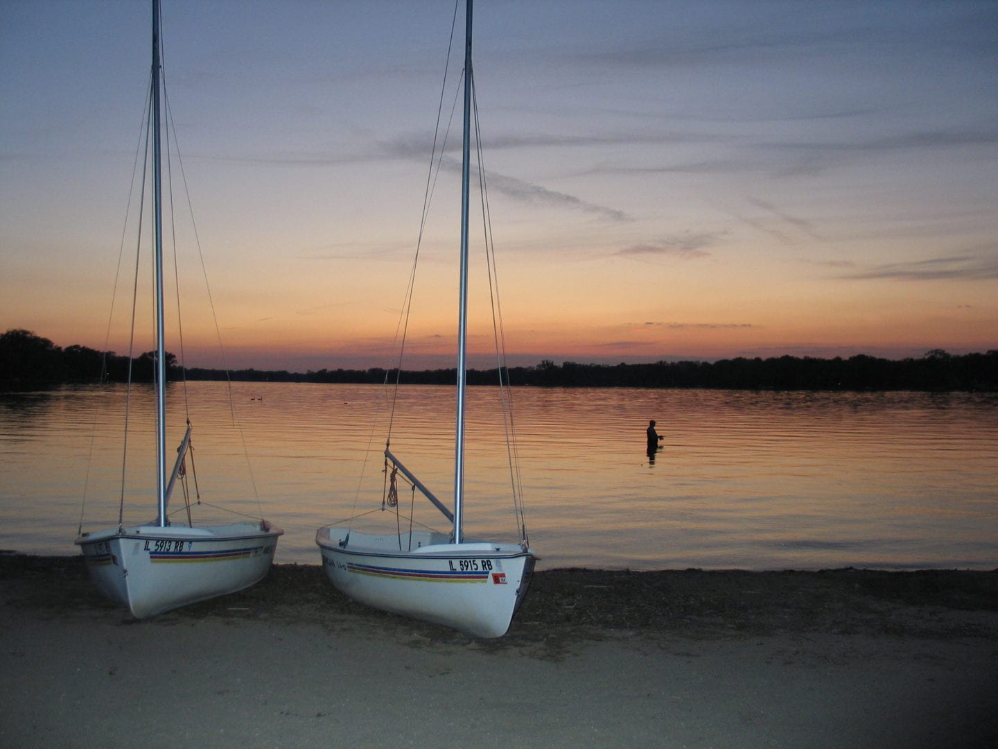 Two sailboats safely on shore