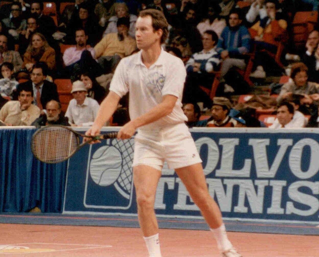 John Mc'Enroe holding a tennis racket