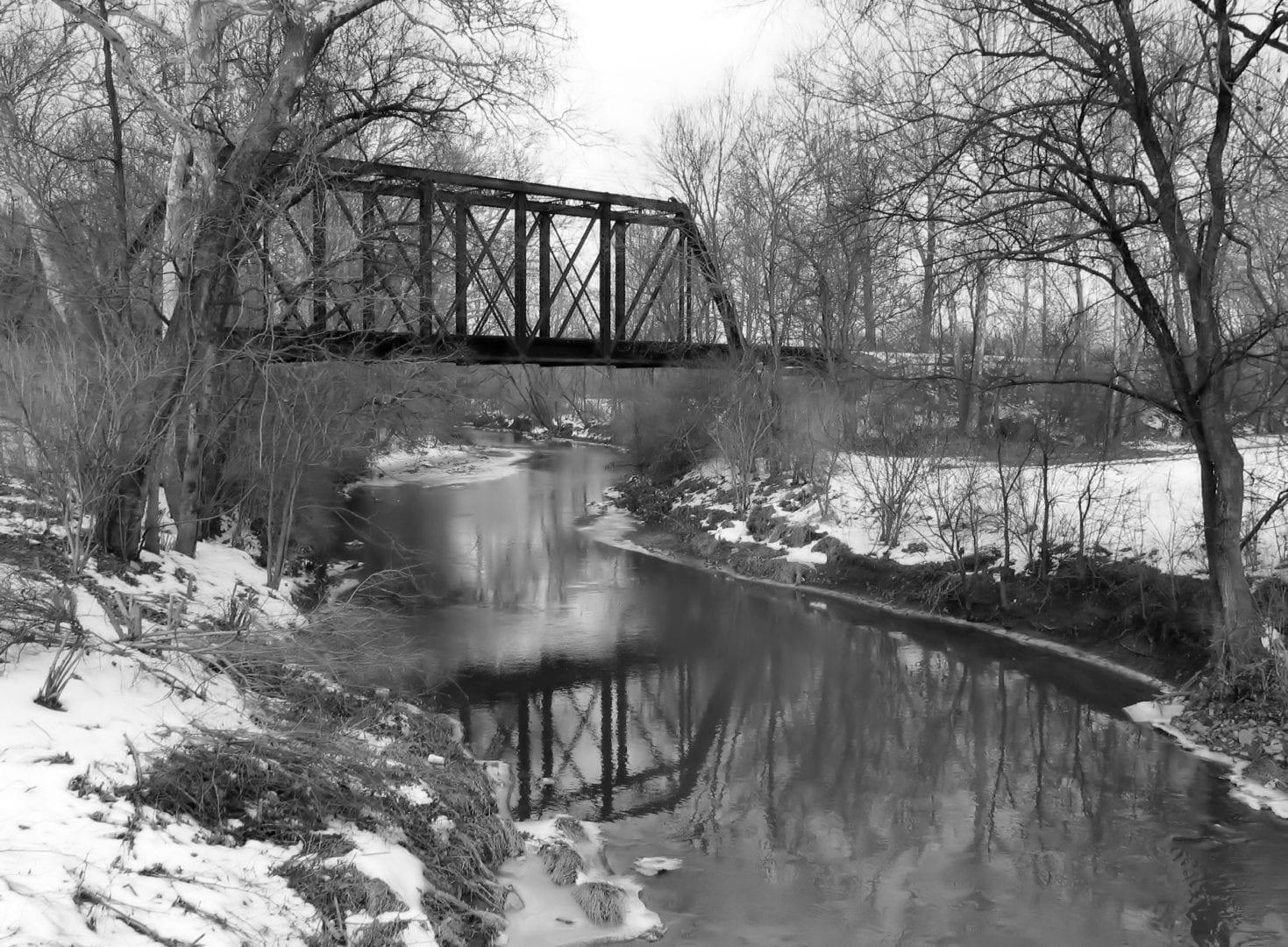 A black and white photo of a bridge