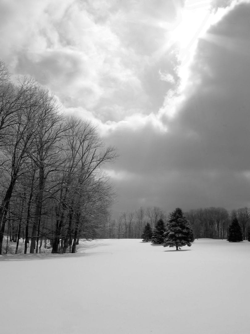 A black and white photo of a snowy landscape