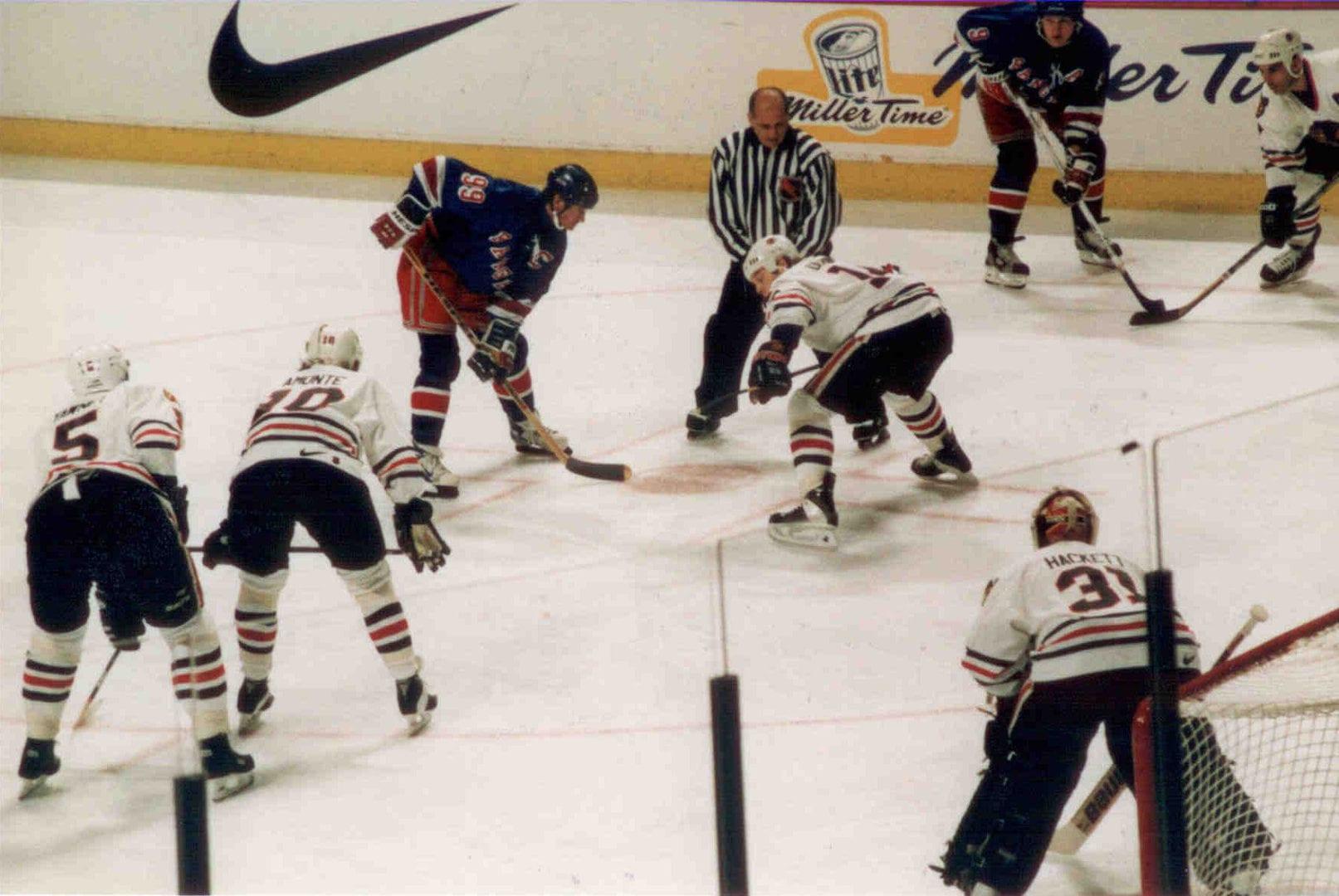 Ice hockey players match off