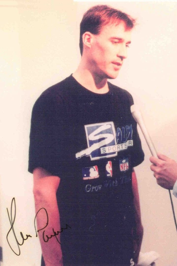 An autographed image of John Paxon during his interview