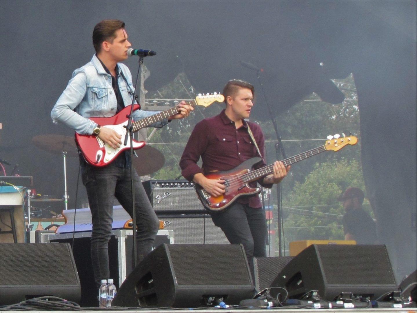 Two men holding guitars