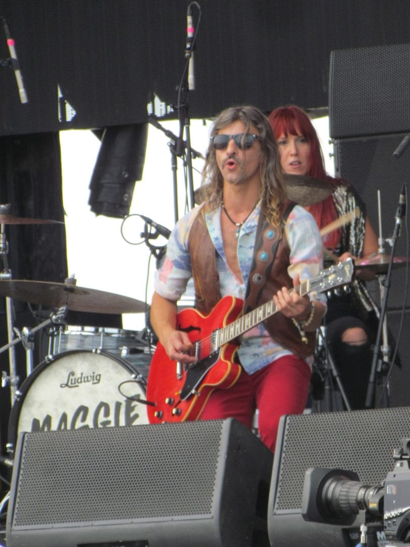 Maggie Rose performing on stage