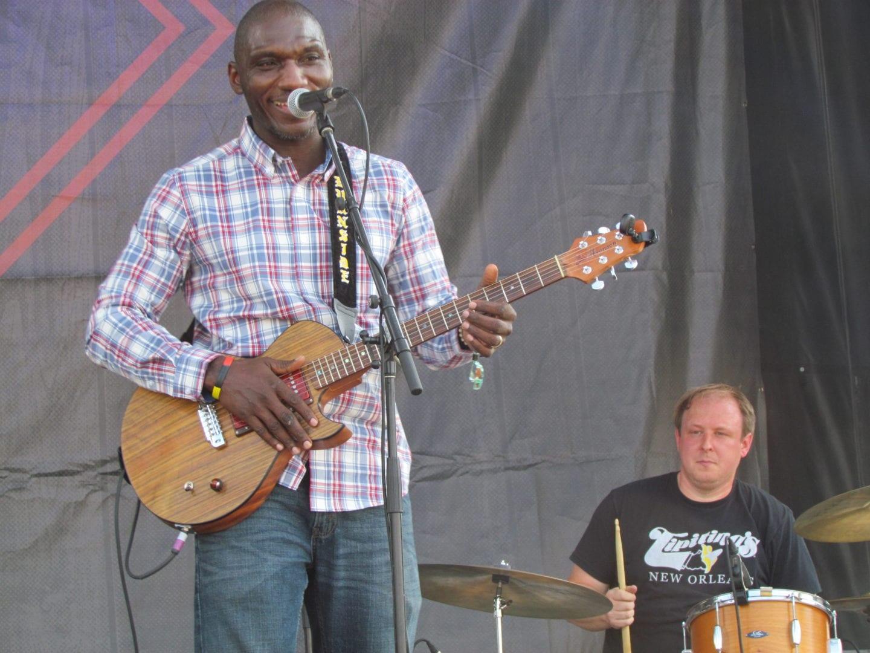 Cedric Burnside playing his guitar