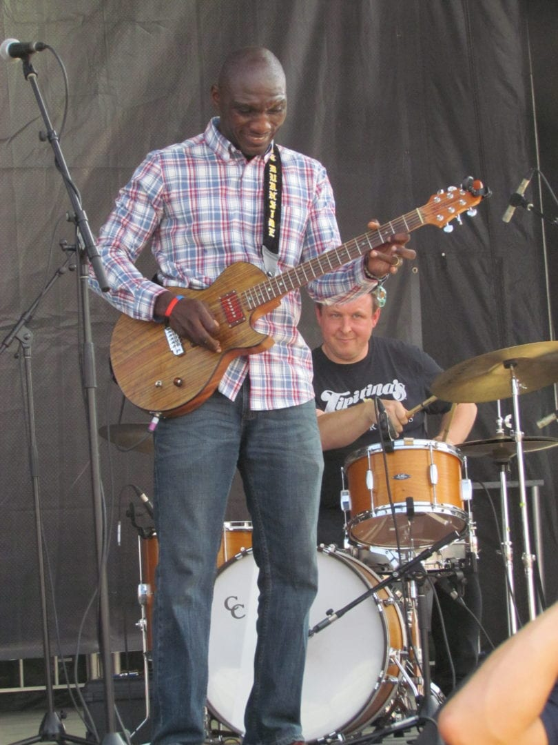 An image of Cedric Burnside performing with his guitar