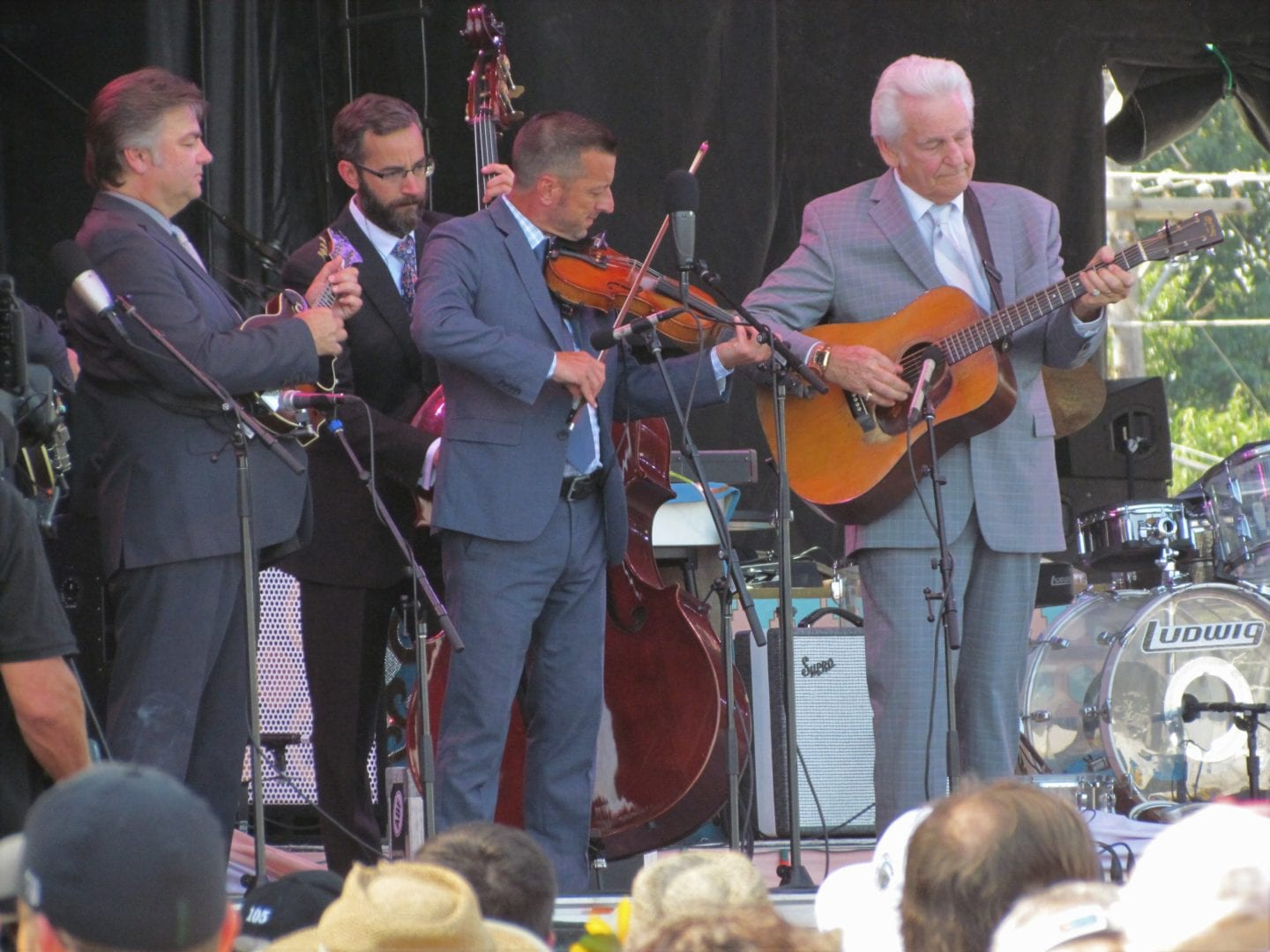 Del McCoury and the band playing instruments