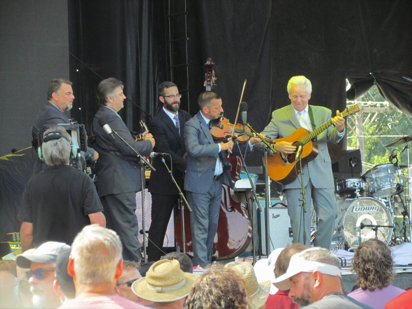 Del McCoury and the band playing stringed instruments
