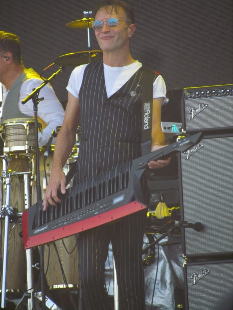 A man playing a keyboard guitar
