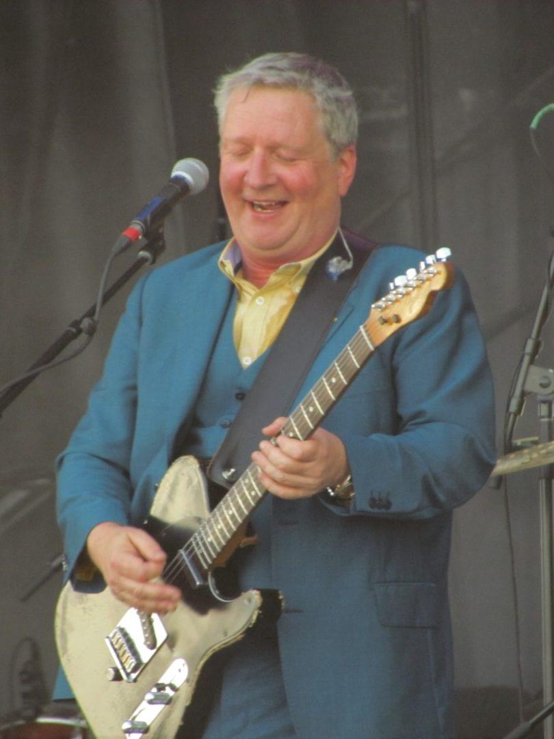 Sqeeze holding a guitar