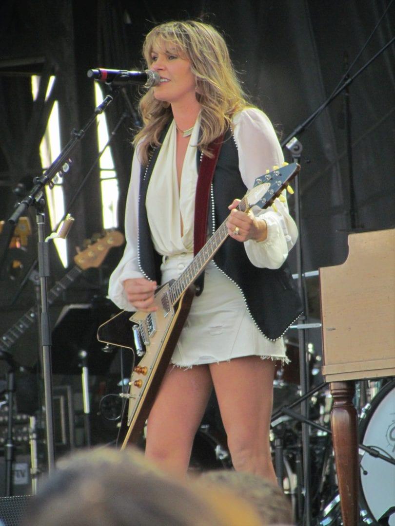 Grace Potter strumming her guitar