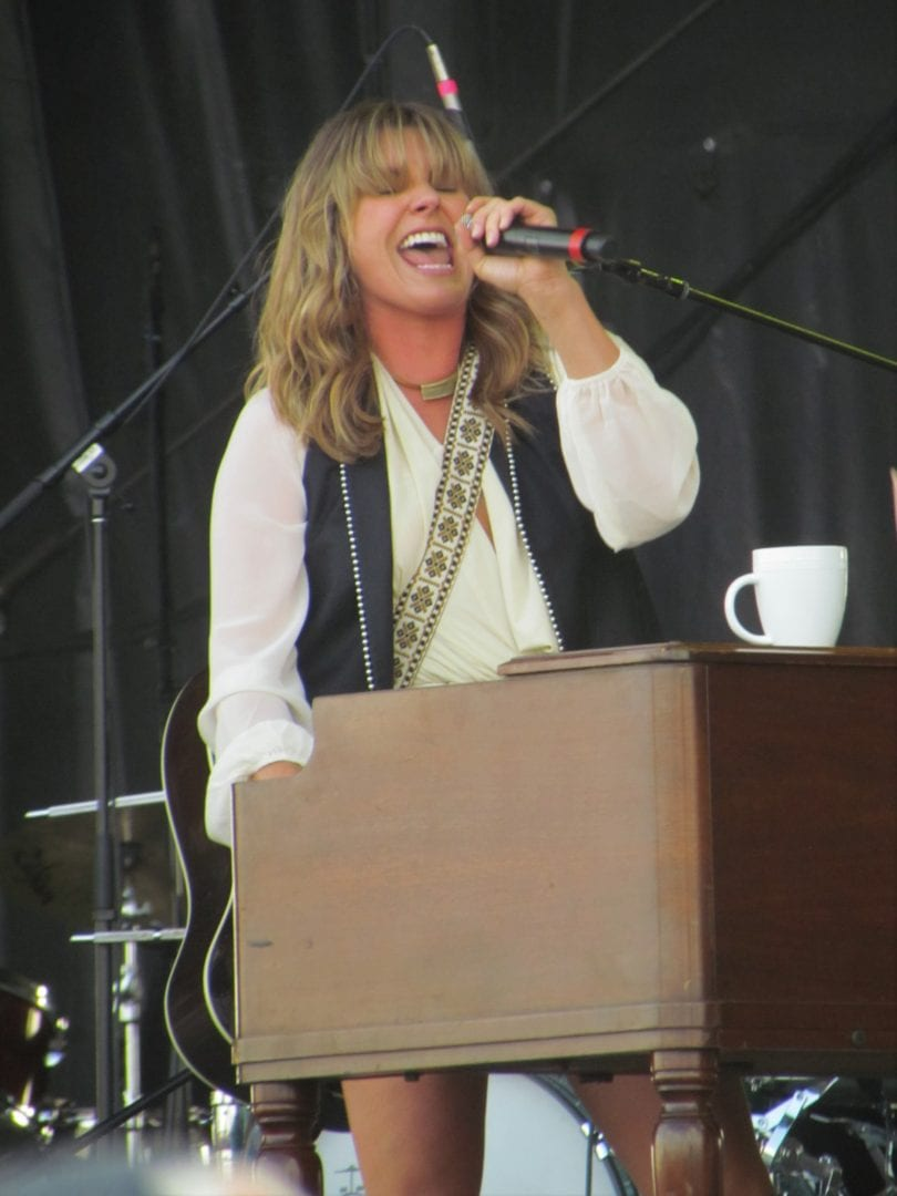 Grace Potter sings while playing piano