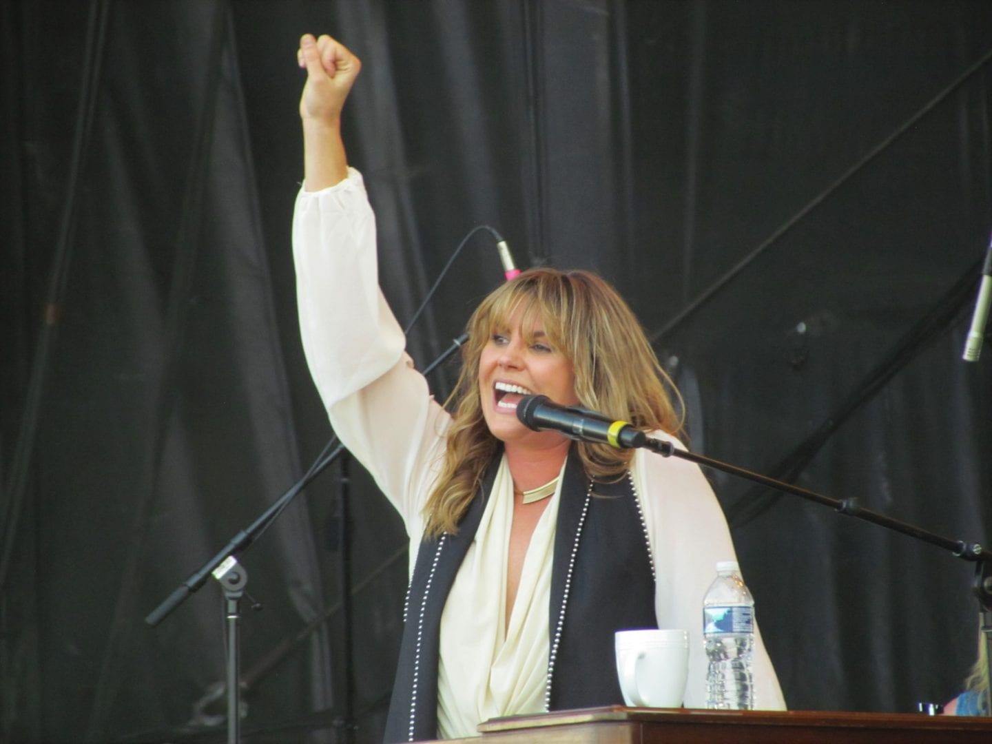Grace Potter talking at the microphone