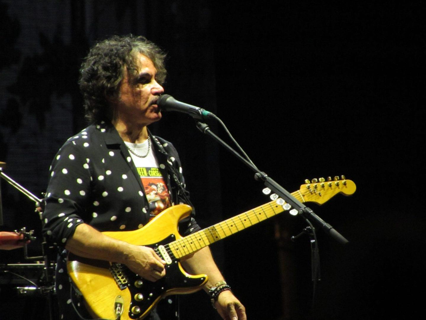 John Oates holding a guitar