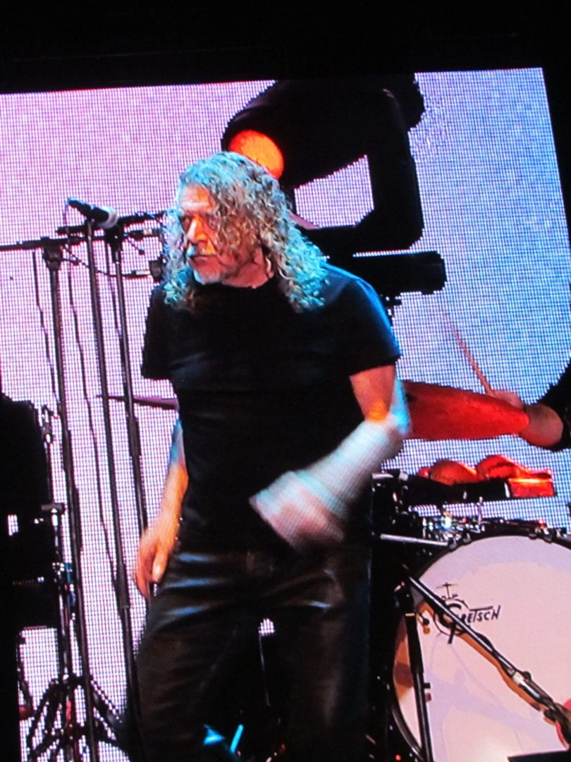 Robert Plant with a screen behind him
