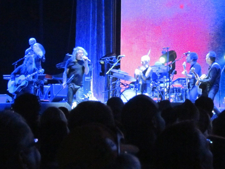 Robert Plant under neon blue lighting