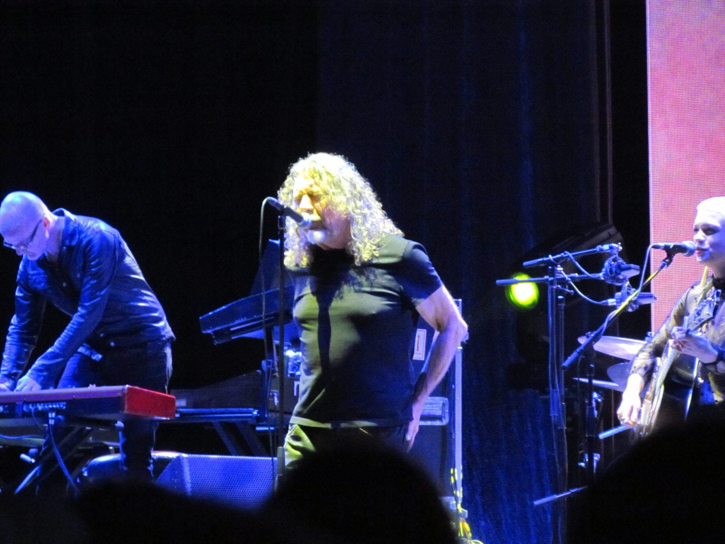 Robert Plant singing with his band