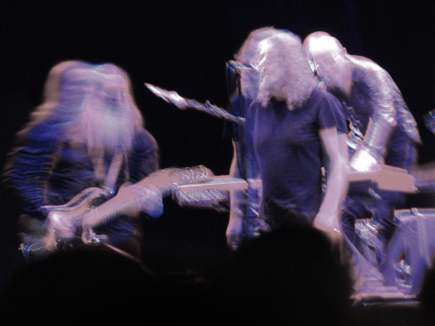A blurry image of Robert Plant