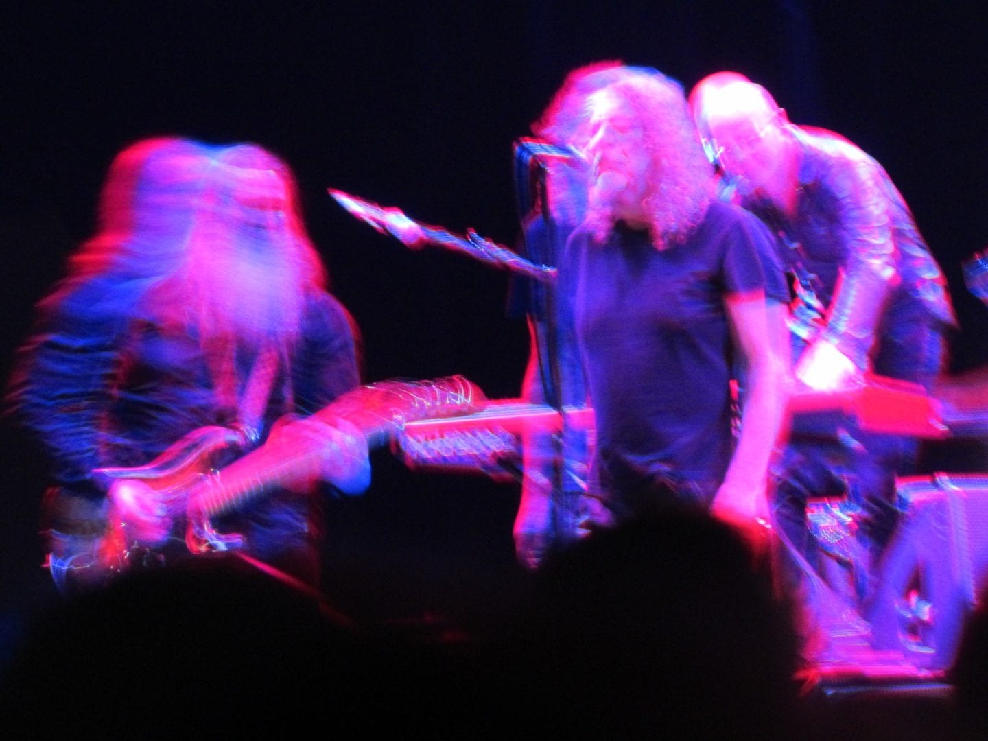 A blurry neon image of Robert Plant