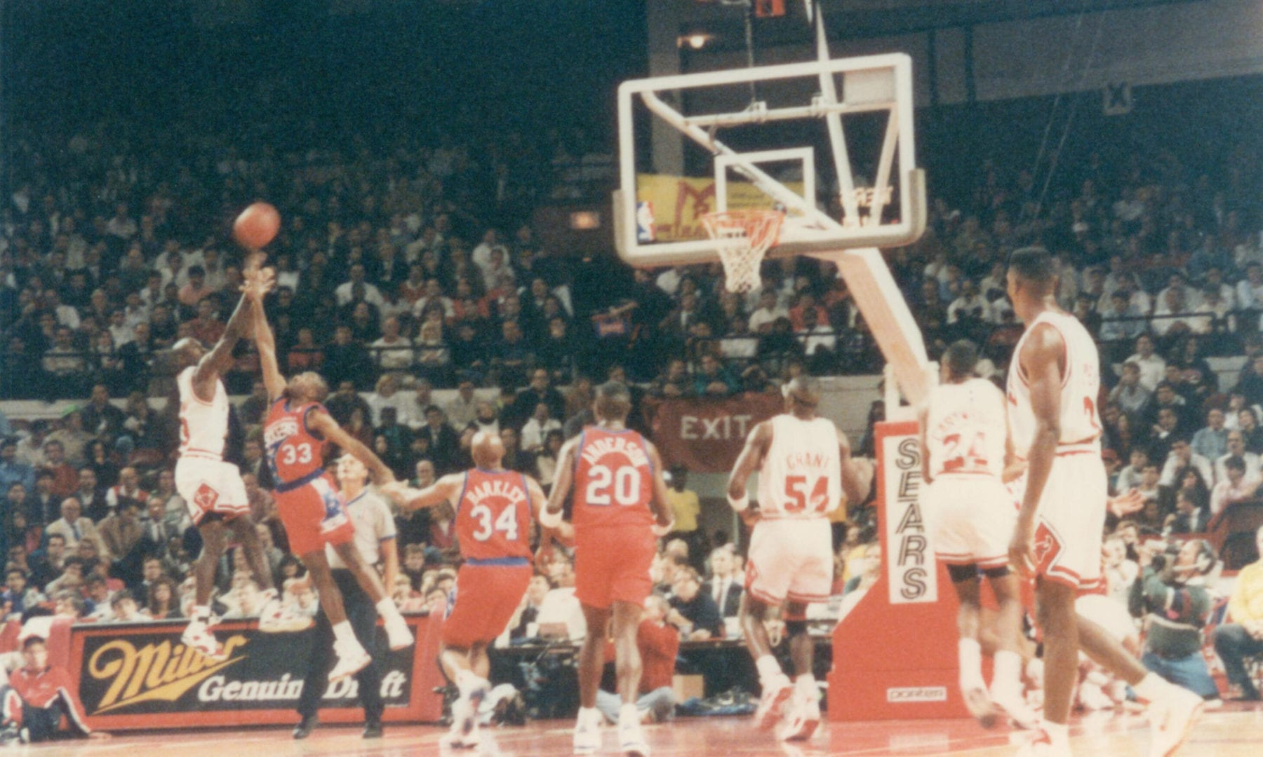 MJ doing a jump shot over Hersey Hawkins