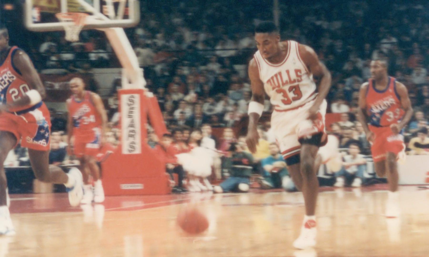 Scottie Pippen dribbling the ball
