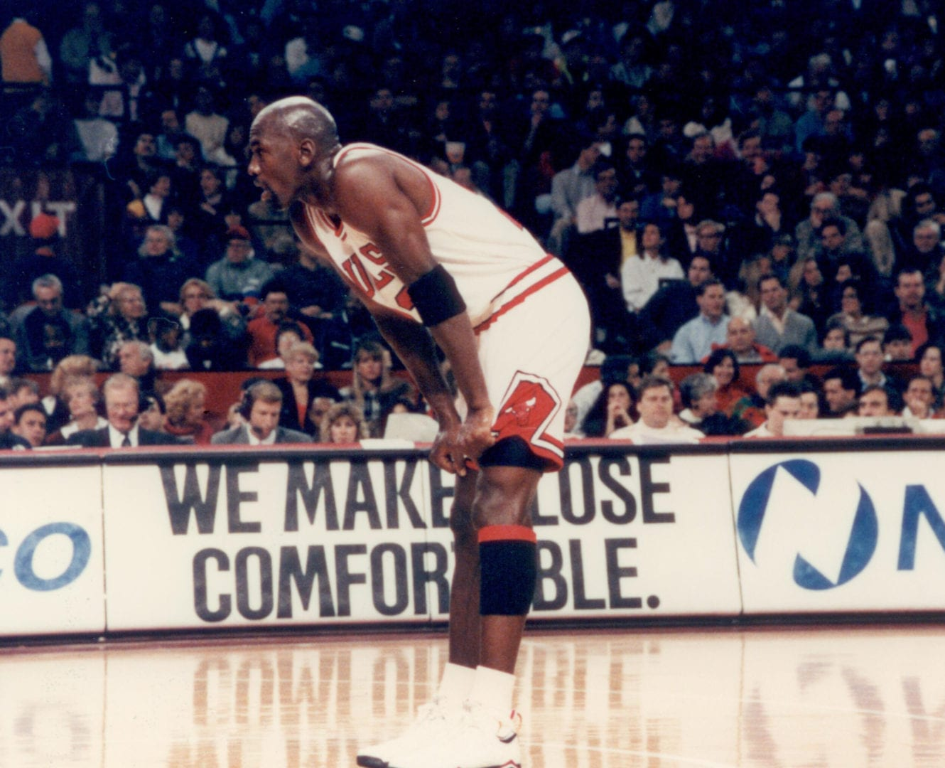 MJ holding his shorts as he takes a break