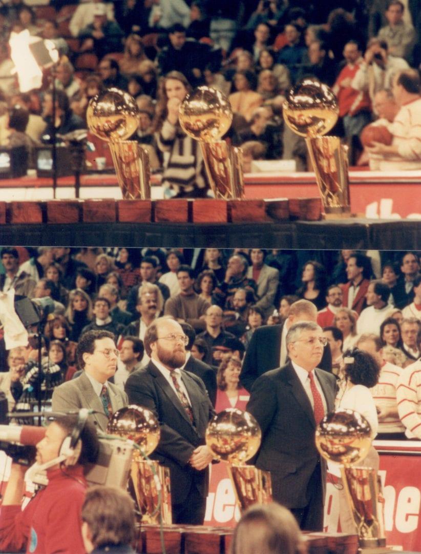 Three NBA championship trophies