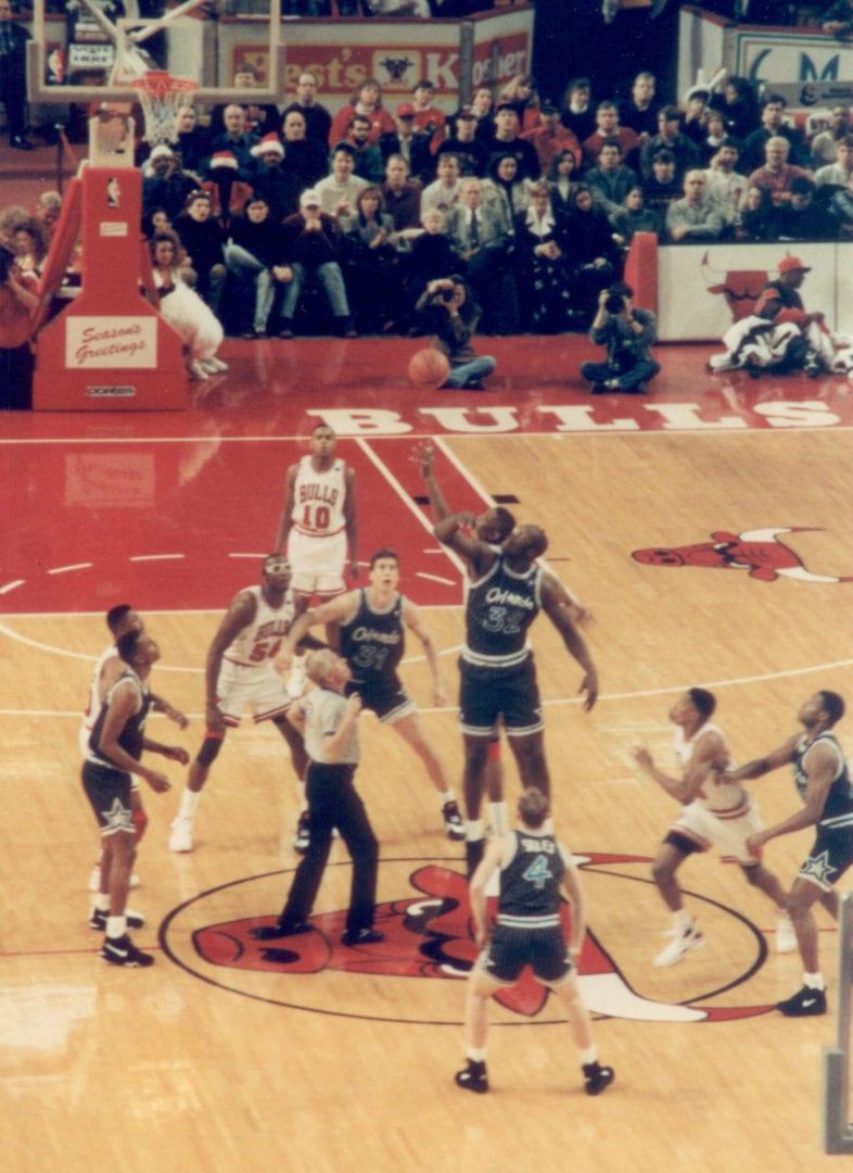 An opening game tipp off between Bulls and Magic