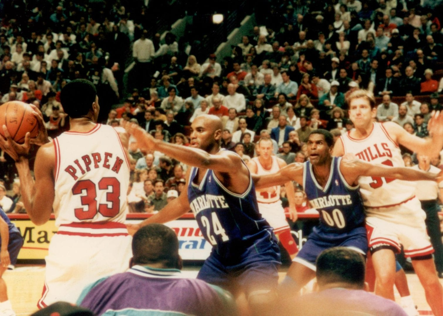 Scottie Pippen about to pass the ball