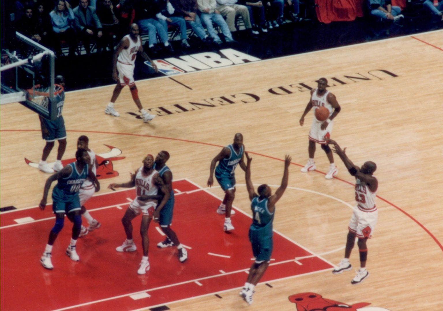 A jump shot of MJ during a basketball game