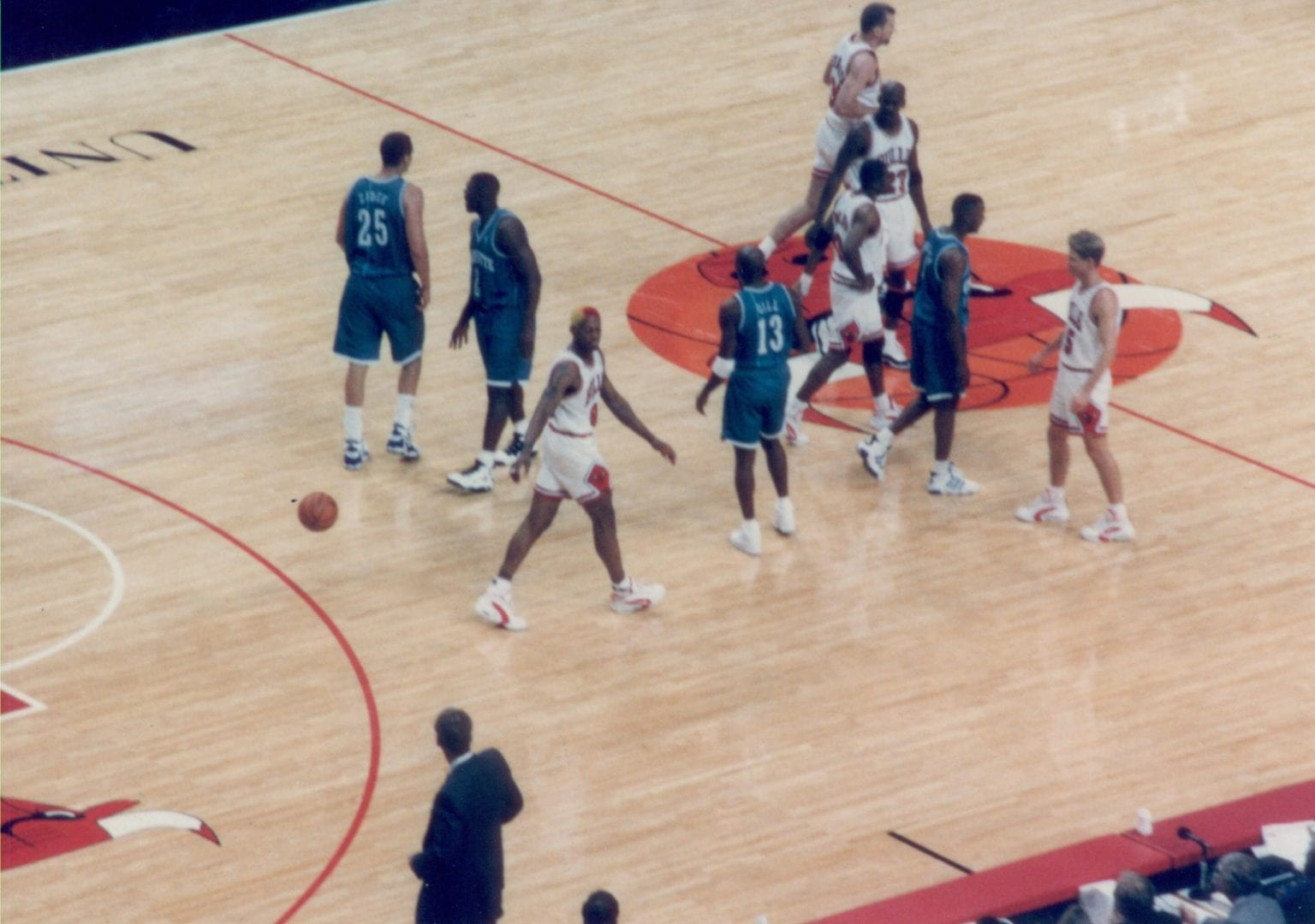 Basketball players inside the court