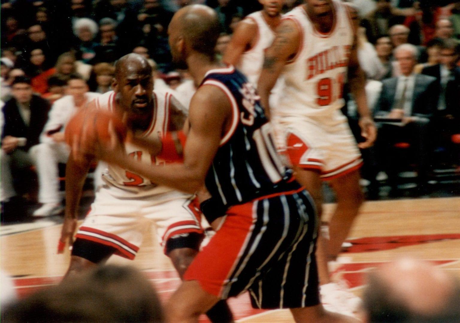Michael Jordan guarding Sam Cassel